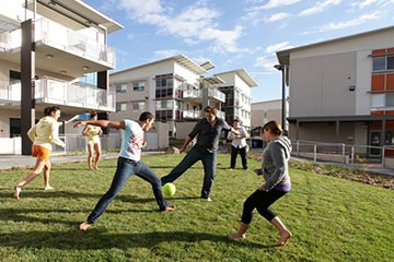 University students playing social soccer.